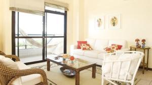Zona de estar de Lindo apartamento de cobertura de frente para o mar com piscina privativa!