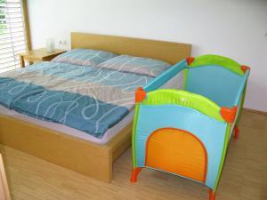 Ein Bett oder Betten in einem Zimmer der Unterkunft Apartments Max