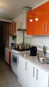 Una cocina o zona de cocina en Departamento residencial en Cuzco