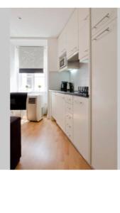 A kitchen or kitchenette at Apartment Beco das Farinhas