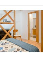 A bed or beds in a room at Apartment Beco das Farinhas