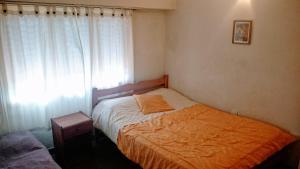 Una cama o camas en una habitación de Departamento en Buenos Aires y PLaya