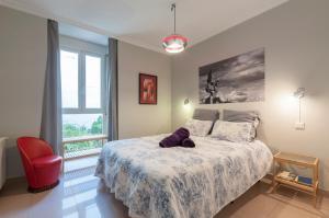 Postel nebo postele na pokoji v ubytování Gran Vía Apartments
