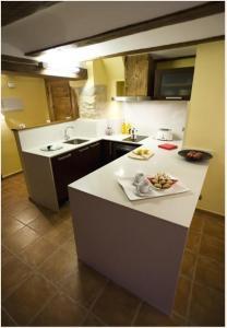 Una cocina o zona de cocina en Apartamentos Doña Candida