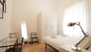 A bed or beds in a room at Italianway-Del Torchio 4