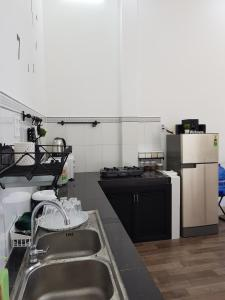 A kitchen or kitchenette at K.P Home