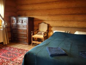 Un pat sau paturi într-o cameră la Green Cottage