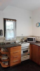 Una cocina o kitchenette en Departamento Cnel.Díaz