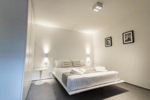 Letto o letti in una camera di Le Ancore Luxury Apartments