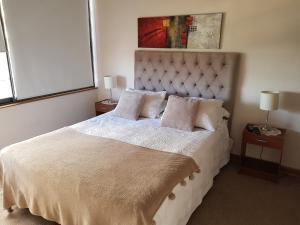 Cama o camas de una habitación en Edificio Fortaleza Depto. 916