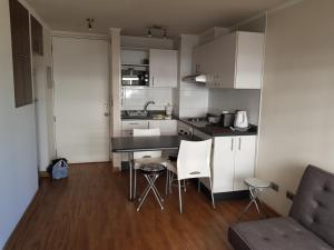 Una cocina o zona de cocina en Edificio Fortaleza Depto. 916
