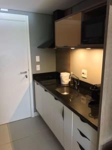 A kitchen or kitchenette at Studio Itaipava