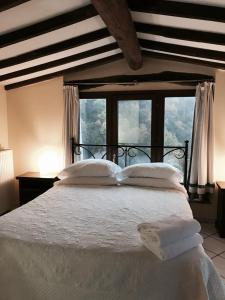 A bed or beds in a room at Borgo Giusto Albergo Diffuso