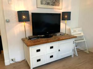 A television and/or entertainment center at Zandvoort Centre Holiday Homes