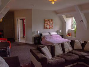 A bed or beds in a room at A Stunning Private Suite In A Beautiful Heritage Mansion