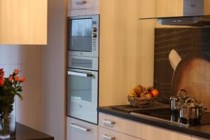 Cucina o angolo cottura di Lux Apartamenty-Złotowska