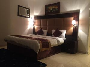 A bed or beds in a room at Alhan Aparthotel