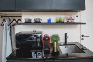Virtuvė arba virtuvėlė apgyvendinimo įstaigoje KODA Stay Mini Villa