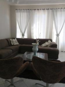 A seating area at Casa de luxo da Nane