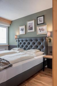 מיטה או מיטות בחדר ב-Apartmenthaus Enzian Hochsölden