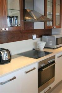 A kitchen or kitchenette at Marine Square Luxury Holiday Suites