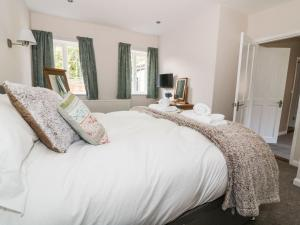 A bed or beds in a room at The Annexe Mill Farmhouse