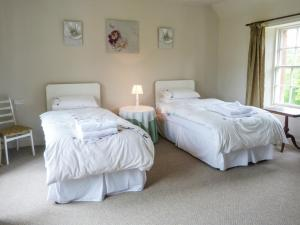 A bed or beds in a room at The Hayfield
