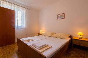 Postelja oz. postelje v sobi nastanitve Apartman Vladimir