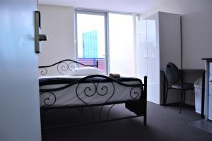 Säng eller sängar i ett rum på Seranin Lane Cove