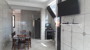 A kitchen or kitchenette at Solar De Maragogi