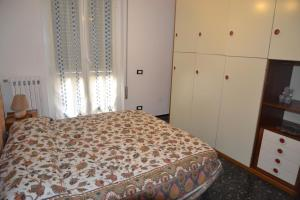 A bed or beds in a room at un passo dal mare