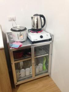 Coffee and tea-making facilities at Feels at Home & Safe in the Heart of Manila