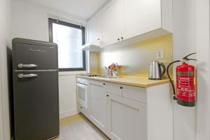 A kitchen or kitchenette at Leidse Square Amsterdam Apartments
