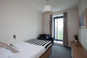 A bed or beds in a room at Chalmers Street - The Meadows (Campus Accommodation)