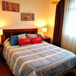 Cama o camas de una habitación en Departamentos K2