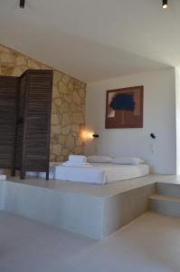 Łóżko lub łóżka w pokoju w obiekcie Kalypso Apartments