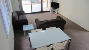 A seating area at Parkside Apartments Parramatta
