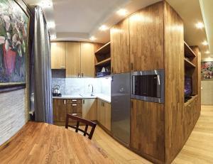 A kitchen or kitchenette at Экостудио на Печерске