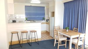 A kitchen or kitchenette at Beach Comber