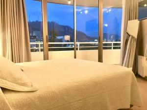 Cama o camas de una habitación en Providencia Plaza