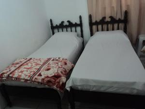 A bed or beds in a room at Casa Férias Foz