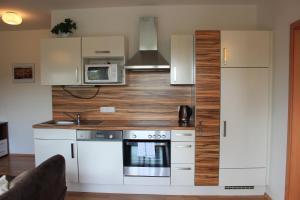 Kuchyň nebo kuchyňský kout v ubytování Promenáda Lipno