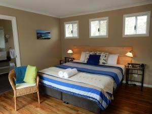 A bed or beds in a room at Cape Howe Cottages
