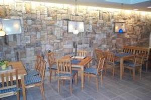 Ein Restaurant oder anderes Speiselokal in der Unterkunft Pension Angergut