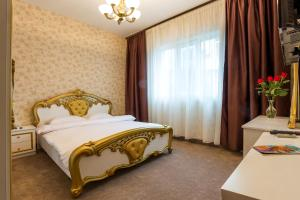 A bed or beds in a room at Deluxe Suite Sofia