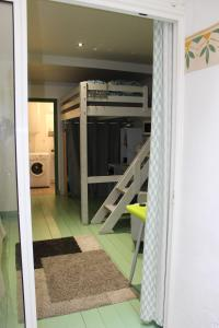 A bunk bed or bunk beds in a room at Mc Nulty's Summerhill Studio