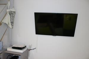 A television and/or entertainment center at Mc Nulty's Summerhill Studio