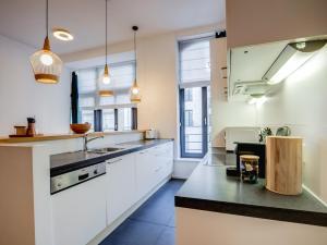 Cuisine ou kitchenette dans l'établissement Sweet Inn Apartments - Châtelain