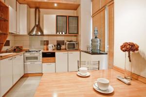A kitchen or kitchenette at StudioMinsk 4 Apartments - Minsk