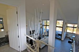 The fitness center and/or fitness facilities at Marina Parque 83 - Clever Details